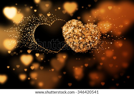 Two hearts and place for your text. Golden background with bokeh effect - stock photo