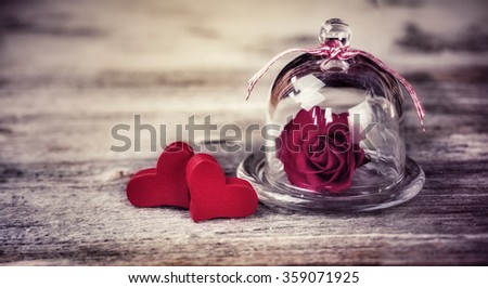 Two Hearts and Rose in a Cloche  - stock photo
