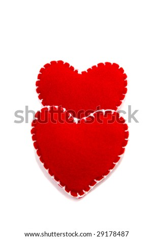Two hearts arranged vertically on a white background - stock photo