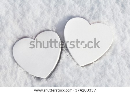 Two hearts in snow valentine's day