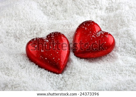 Two hearts in the snow - stock photo