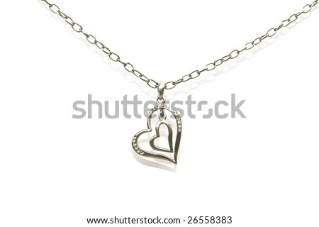 Two hearts necklace isolated on white background. - stock photo