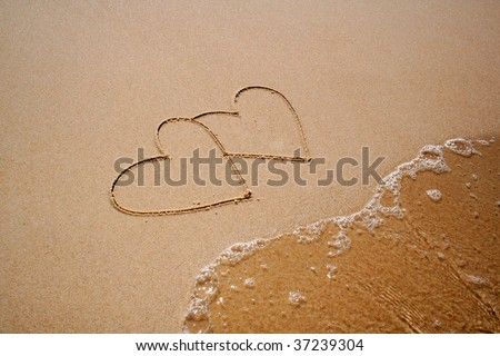 two hearts on sand - stock photo