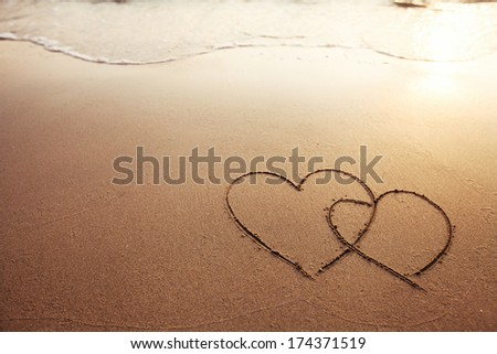 two hearts on the beach - stock photo