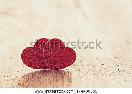 two hearts on wood with copy space  - stock photo