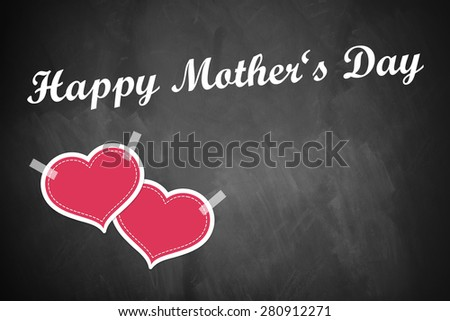 """two hearts taped on a blackboard with a """"Happy Mother's Day"""" message - stock photo"""