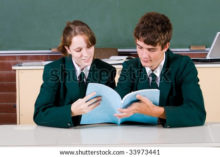two high school students studying in classroom - stock photo