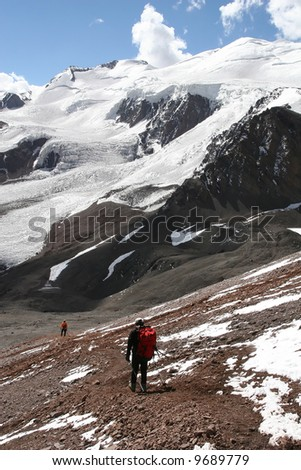 Two hikers descending Aconcagua's Normal Route - stock photo