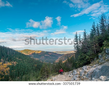 Two hikers going up the Alpine trail in the High Tatra, Poland - stock photo