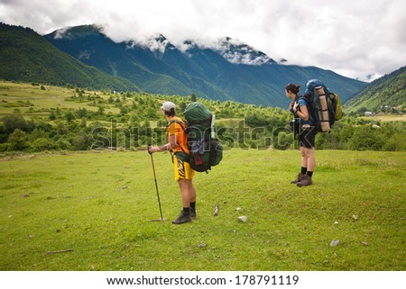 Two hikers in Caucasus mountains, Georgia. - stock photo
