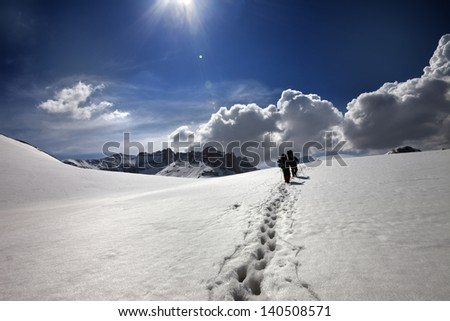 Two hikers on snow plateau. Turkey, Central Taurus Mountains, Aladaglar (Anti-Taurus), plateau Edigel (Yedi Goller) - stock photo
