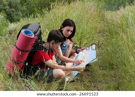 two hikers on the rest - stock photo