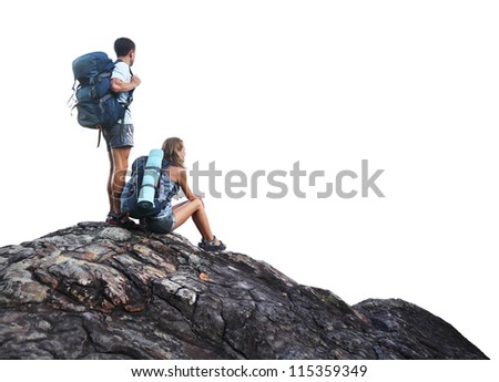 Two hikers with backpacks on top of a mountain isolated on a white - stock photo