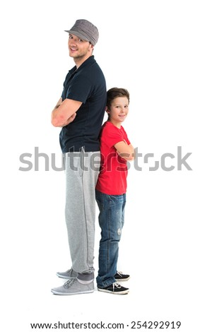 Two hip hop dancers isolated on white background. small boy and adult man back to back - stock photo