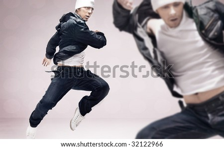 Two hiphop dancers - stock photo