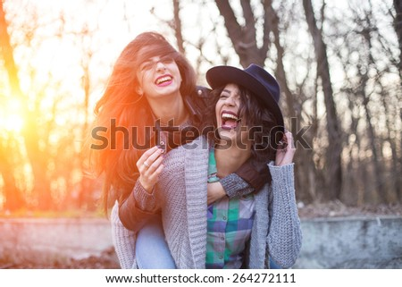 Two hipster friends goofing around - stock photo