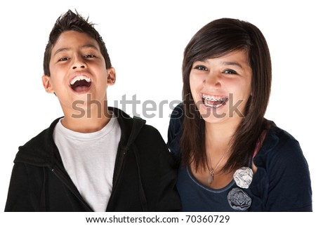 Two hispanic kids laughing on white background - stock photo