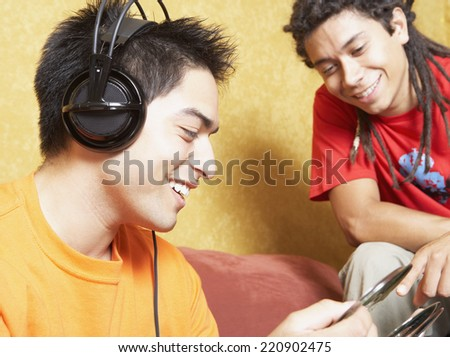 Two Hispanic men looking at cds - stock photo
