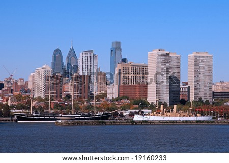 "Two Historic ships, the square-rigged sailing ship ""Mosholu"" and the cruiser USS Olympia, are moored at Philadelphia's Penn's Landing - stock photo"