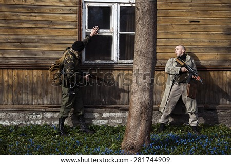 Two hitmans are ready to start attacking - stock photo