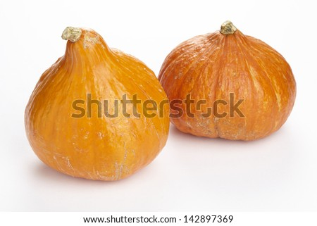 Two hokkaido pumpkins exempted on a white background.