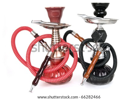 Two hookahs on a white background - stock photo