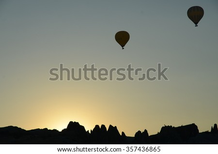 Two Hot-air balloons in the sky during sunrise in Cappadocia - stock photo