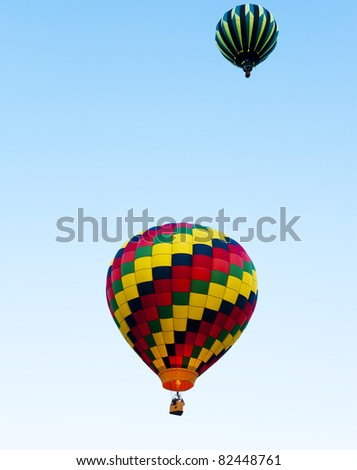 Two Hot Air Balloons with One Shooting Flames into the Balloon