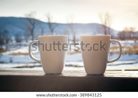 two hot chocolate cups outdoors