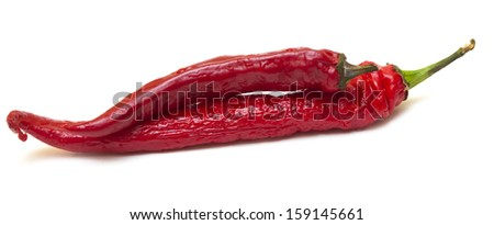 Two hot red peppers isolated on white background