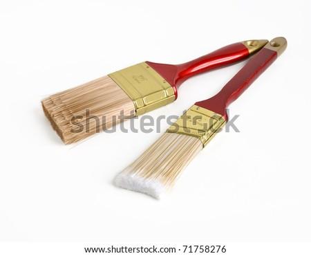 Two house paint brushes on white background - stock photo