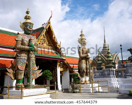 Two huge demons statue in the Grand Palace, Bangkok, Thailand.  - stock photo