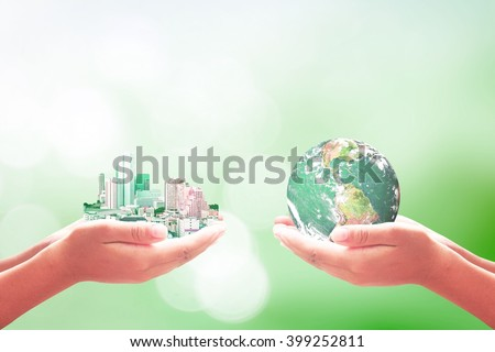 Two human hand hold beautiful big city and Green planet. World Environment Day Quality Finance Learning CSR Education Trust Water Sea Hope Vision ROI concept. Elements of this image furnished by NASA. - stock photo