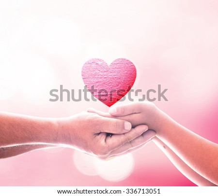 Two Human Hand Hold Red Heart Generosity Gift Share Dream Wish World Cupid Give God Graft Family Cancer Kidney Donor Charity Idea CSR Pink Palm Healthy Support Mother Pray Parent Pardon Blood concept - stock photo
