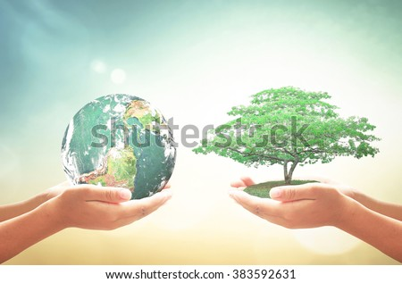 Two human hand holding planet and tree. CSR Investment Kindness Clean Recycle Arbor Spring Time Rethink Reduce Reuse Recycle Recondition Refuse Return concept. Elements of this image furnished by NASA - stock photo