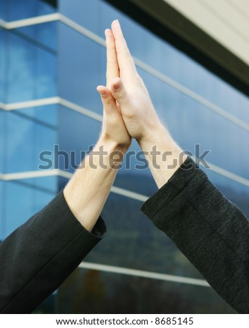 two human hands touching palms - stock photo