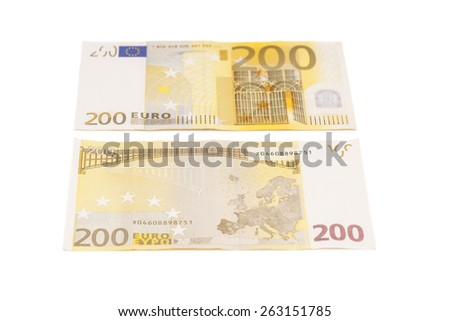 Two hundred euro banknotes isolated on a white background - stock photo