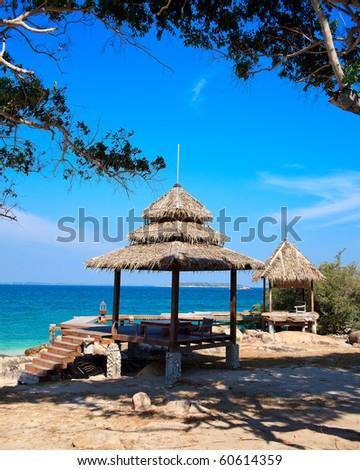 Two huts near the sea beach - stock photo