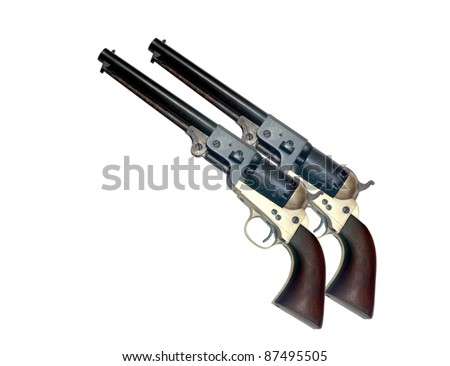 two identical old metal colt revolver on white background - stock photo