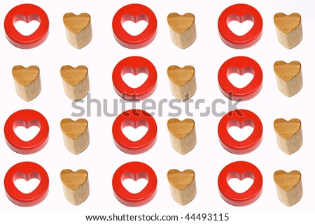 Two identical wooden hearts surrounded by couples of red and wooden hearts - stock photo