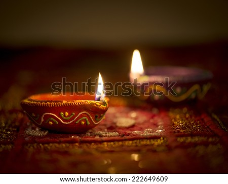 Two illuminated indian oil lights. Diwali Greetings. - stock photo