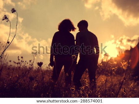 Two in love people evening silhouette  - stock photo