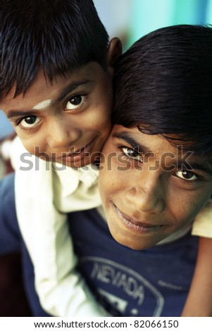 Two Indian boys posing to the camera. - stock photo