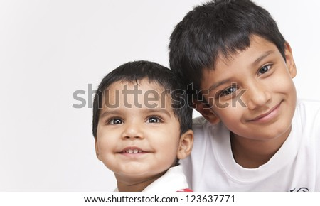 Two Indian brothers in indoors