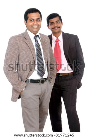 Two Indian business people posing to the camera, isolated on white.
