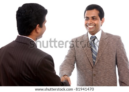 Two Indian business people shaking hands
