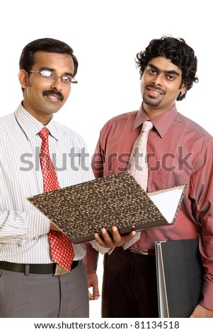 Two Indian business peoples with files on white - stock photo