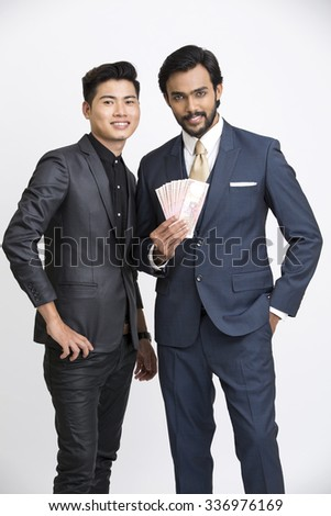 Two Indian businessman with rupees on white background.