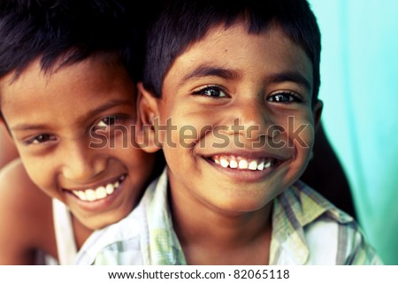 Two Indian happy teen boys posing to the camera. - stock photo