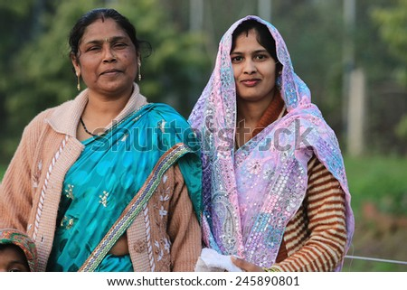 Two indian women at the streets of New Delhi. 21 February 2013.  India - stock photo